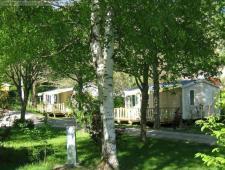 vente d'un camping sur environ 3500m² de terrain arborés en très bon état