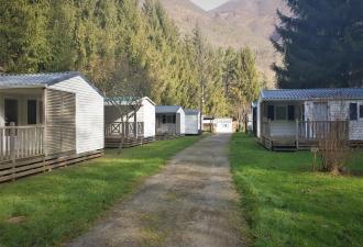 vente d'un beau camping dans les pyrénées en bord d'une rivière à seulement 10 minutes des piste